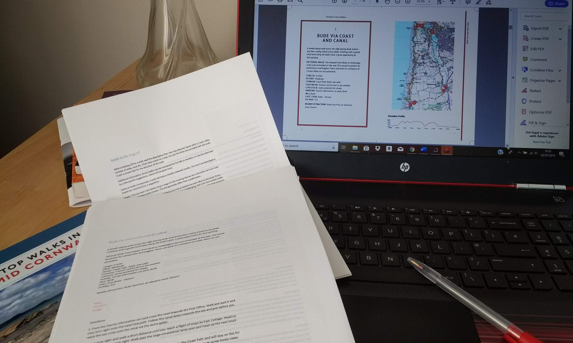 Photo of laptop and copy documents of a proofreading job