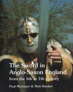 Front cover of a book on the sword in anglo-saxon England that I worked on. The cover shows a 7th century warrior with a full face helmet holding a sword